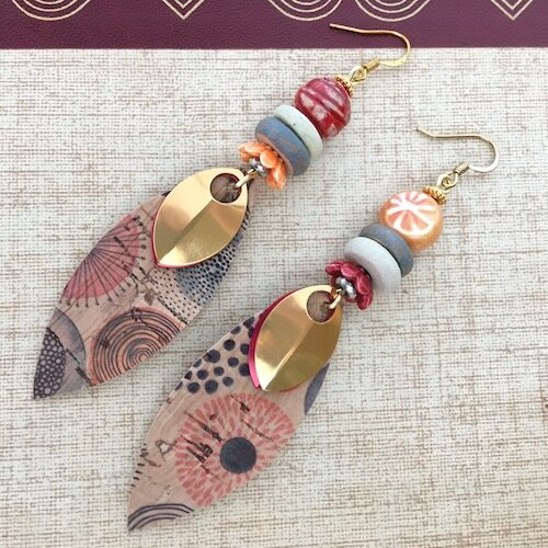 Red and orange gently asymmetrical earrings with petal shaped drops